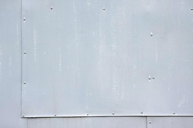 Fundo de aço cinza rebitada com espaço para texto