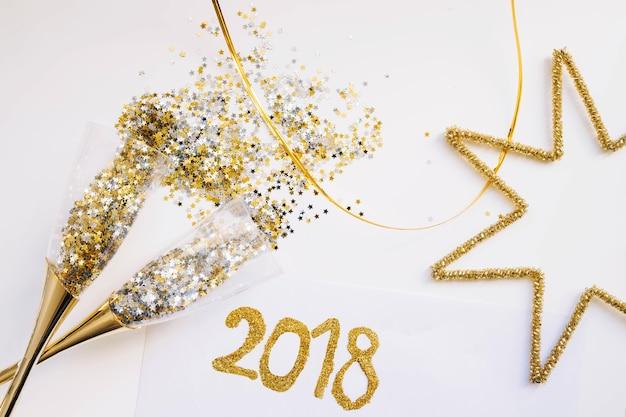 Fundo de ano novo com óculos e estrela Foto gratuita