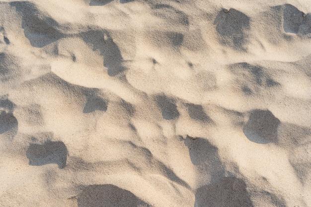 Fundo de areia bonito e texturizado na praia tropical