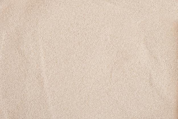 Fundo de areia, textura de areia clara, cópia de espaço de vista superior