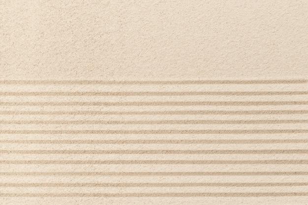 Fundo de areia zen listrado no conceito de bem-estar