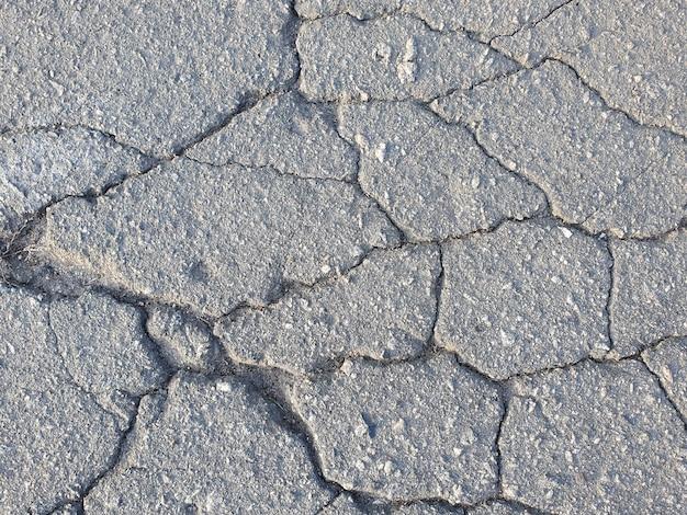 Fundo de asfalto horizontal com rachaduras