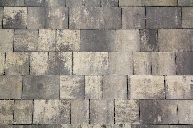 Fundo de azulejos cinza.