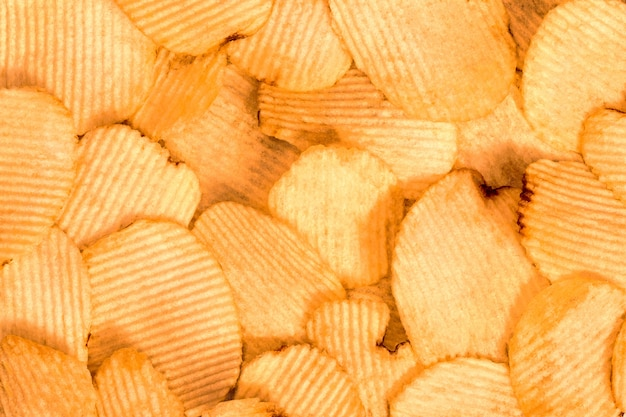Fundo de batatas fritas. textura de lanche de fast-food.