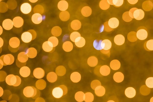 Fundo de bokeh dourado iluminado