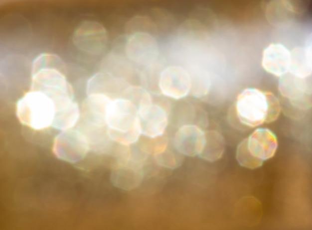 Fundo de bokeh, tom dourado de uma textura dourada brilhante