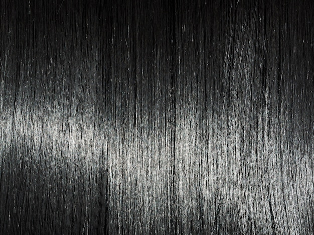 Fundo de cabelo preto reto brilhante. cabelo moreno liso bonito