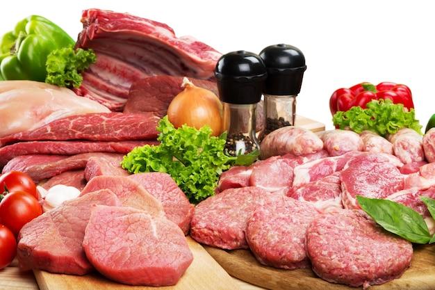 Fundo de carne crua fresca com vegetais