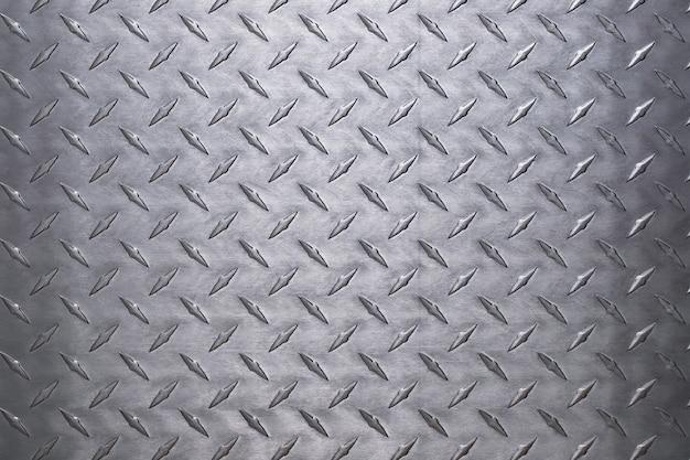 Fundo de chapa de alumínio leve, metal prateado com textura de diamante.