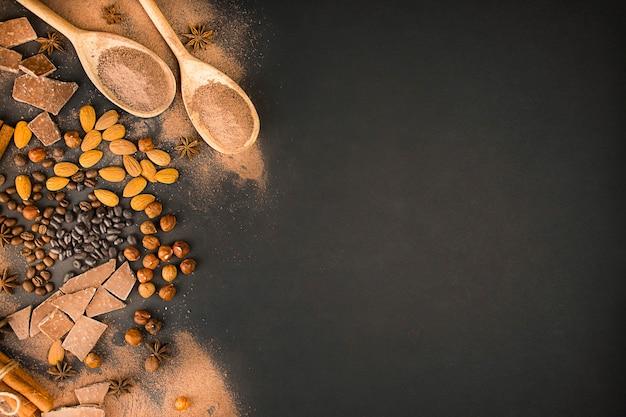 Fundo de chocolate de diferentes tipos de nozes, fatias de chocolate, grãos de café e cacau. copie o espaço. bandeira.