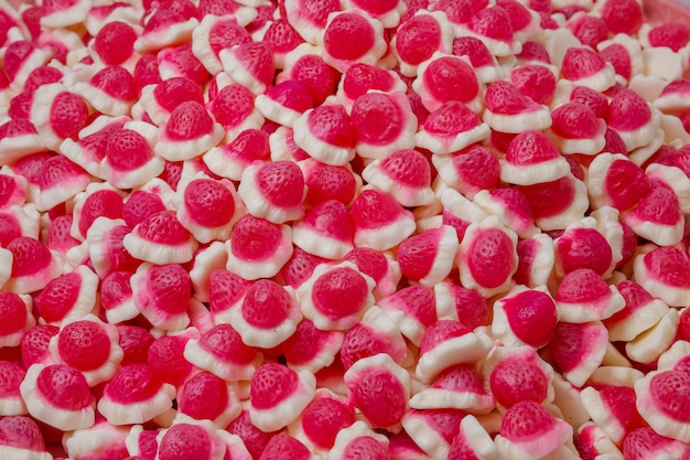 Fundo de close-up de doce de gelatina de morango e framboesa gummi
