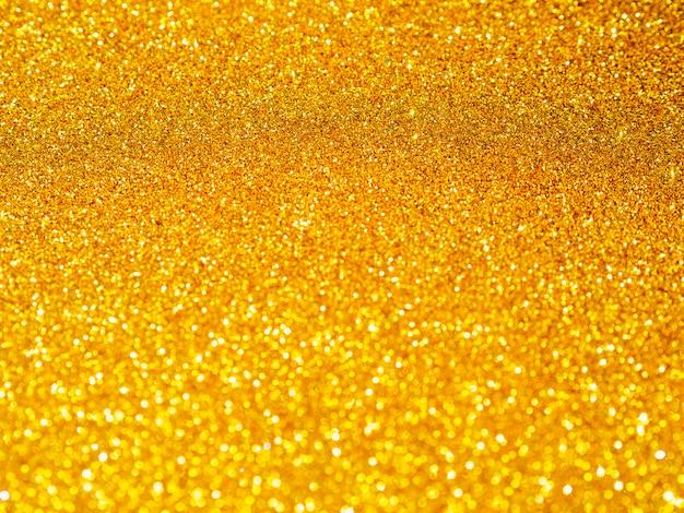 Fundo de close-up de glitter dourado