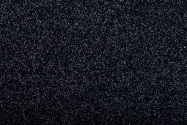 Fundo de cobertura de tapete. padrão e textura do tapete de cor preta. copie o espaço