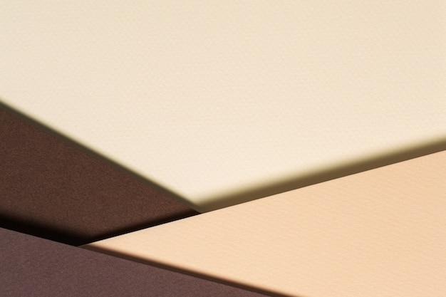 Fundo de composição de geometria de papéis de cor abstrata com tons bege e marrom