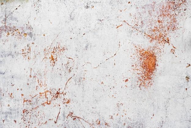 Fundo de concreto da parede de textura. fragmento de parede com arranhões e rachaduras
