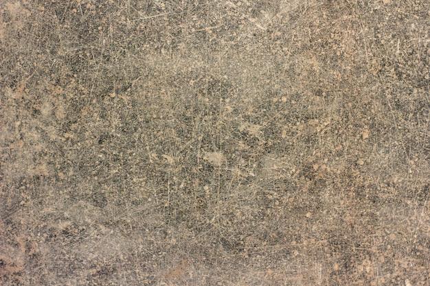 Fundo de concreto de parede textura. fragmento de parede com arranhões e rachaduras
