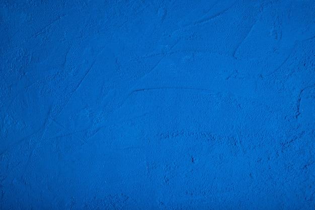 Fundo de concreto poroso azul escuro