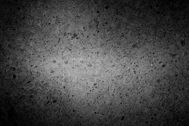 Fundo de concreto preto com uma área clara no meio