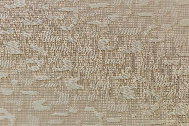 Fundo de cor dourada de textura de tecido closeup