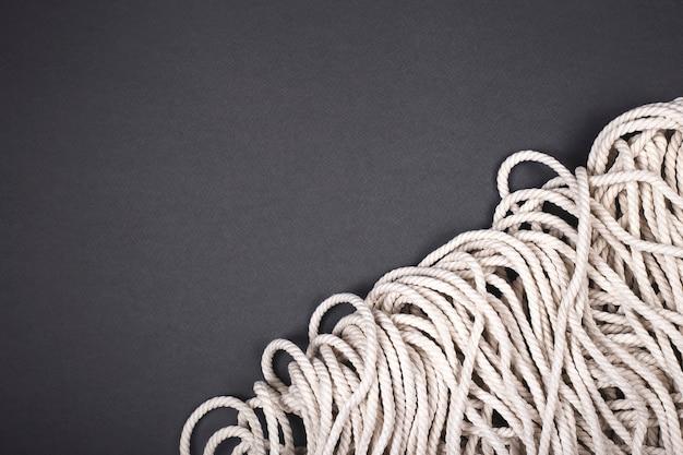 Fundo de corda branca de algodão minimalista com textura e contraste.