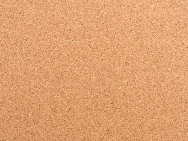 Fundo de cortiça. textura de papel pardo. padrão abstrato. cenário de madeira. parede de papelão. madeira compensada. textura de cortiça Foto Premium