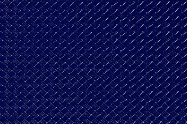 Fundo de couro azul marinho com textura de imitação de tecer. estrutura de couro artificial brilhante.