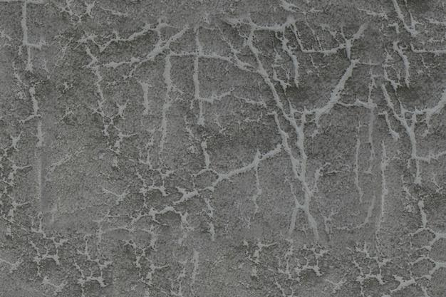 Fundo de couro cinza. superfície estrutural com um padrão.