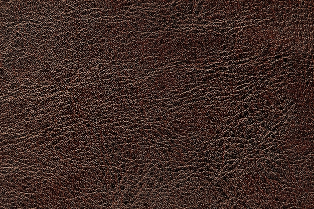 Fundo de couro da textura do marrom escuro, close up. pano de fundo rachado de bronze da pele do enrugamento