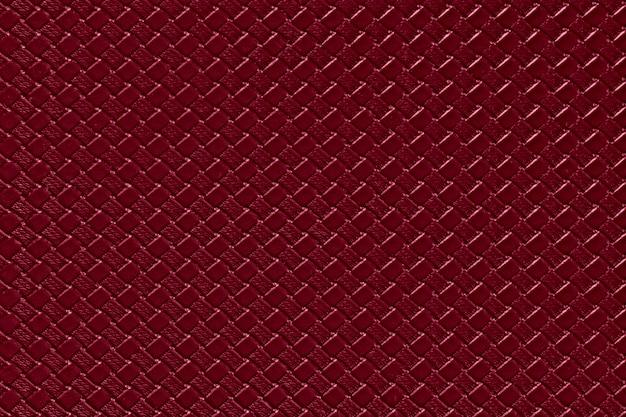 Fundo de couro de borgonha com textura de imitação do weave. estrutura de couro artificial brilhante.