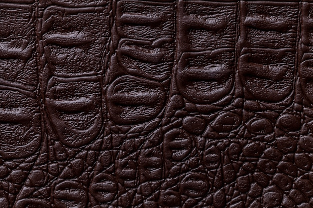 Fundo de couro marrom escuro, closeup