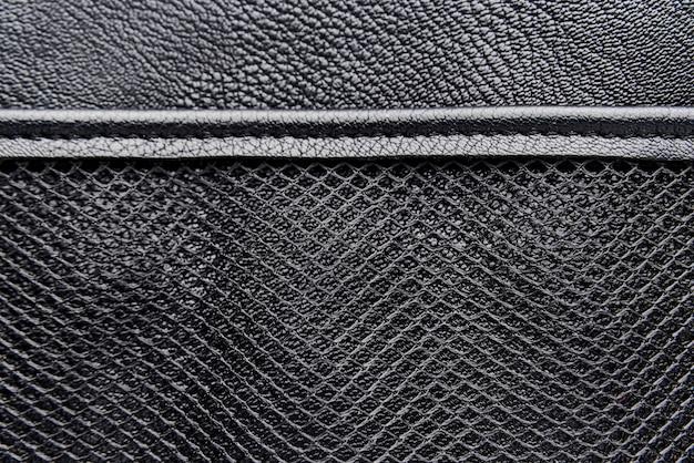 Fundo de couro preto com malha.