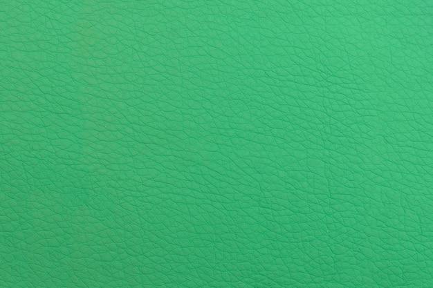 Fundo de couro verde. superfície estrutural com um padrão.
