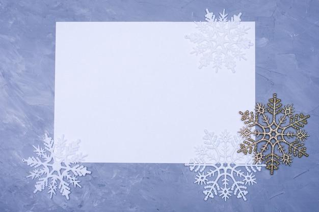 Fundo de decoração de natal - flocos de neve em fundo azul