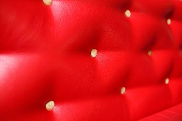 Fundo de designer ou textura de couro acolchoado vermelho close-up