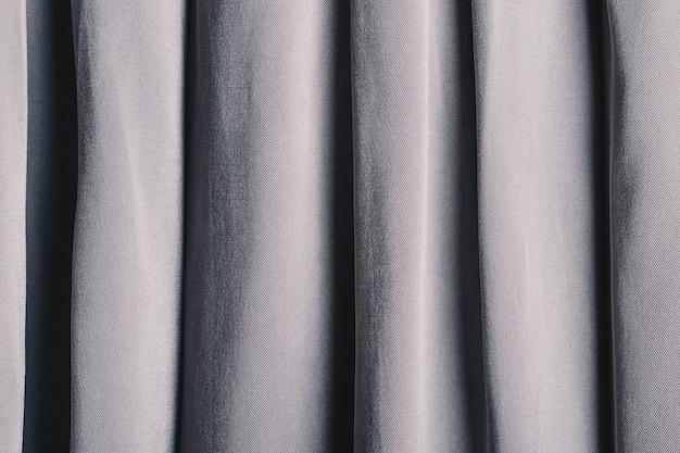 Fundo de dobras dobradas em tecido cinza