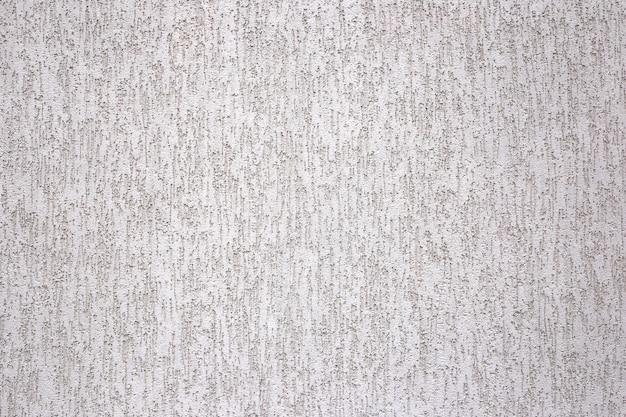 Fundo de estuque cinza arranhado na parede gesso de fachada cinza com arranhões e reentrâncias