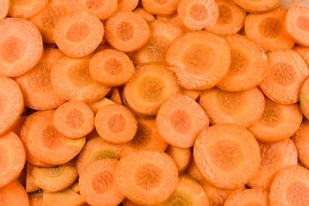 Fundo de fatias de cenoura fresca