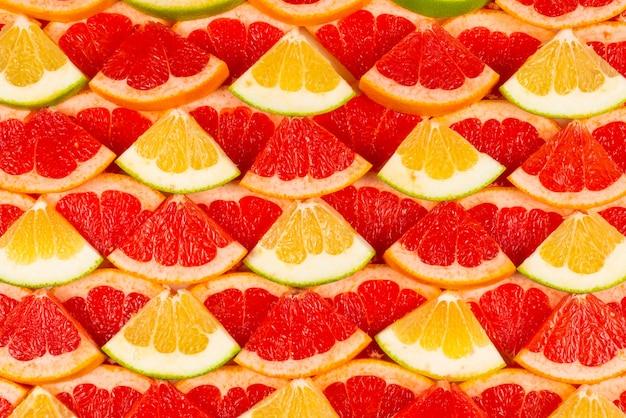 Fundo de fatias de pomelo e toranja