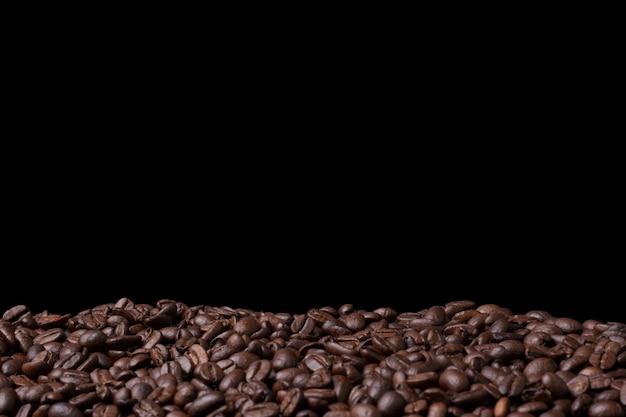 Fundo de feijão de café fresco closeup com copyspace