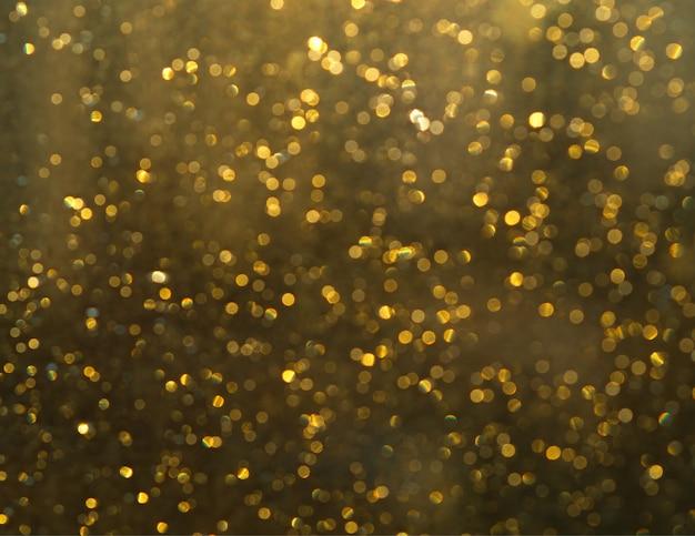 Fundo de foco bokeh dourado brilhante