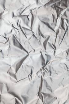 Fundo de folha de alumínio amassado.