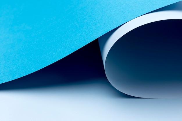 Fundo de folhas de papel azul