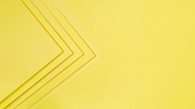 Fundo de formas de papel amarelo