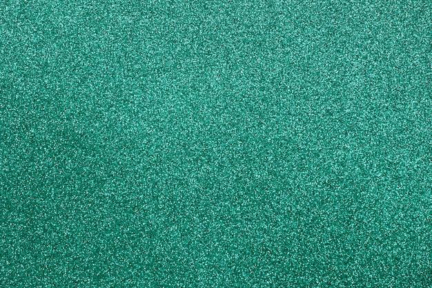 Fundo de glitter textura verde focada