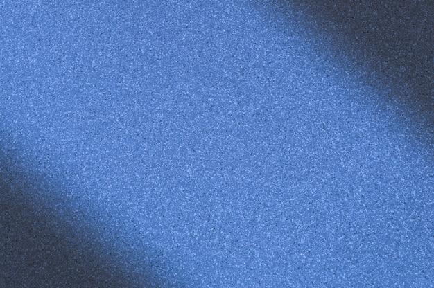 Fundo de granito com cor azul com pequenos pontos. escurecimento à esquerda e à direita na diagonal.