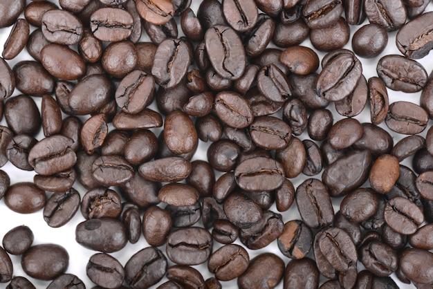 Fundo de grãos de café espalhados