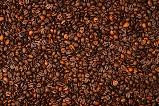 Fundo de grãos de café. vista do topo. textura de grãos de café.