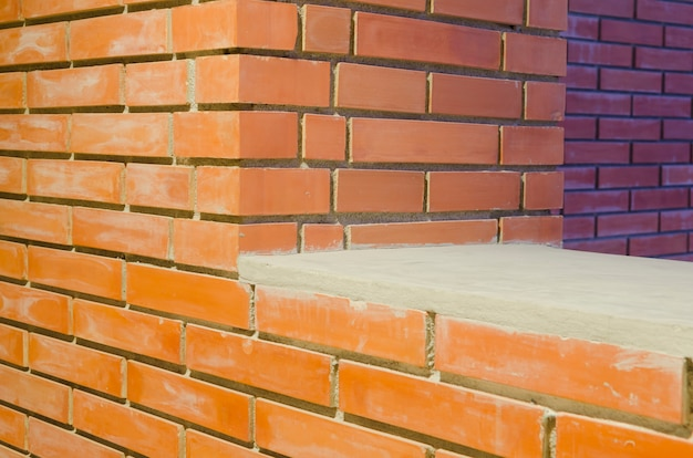 Fundo de grunge de textura de parede de tijolo vermelho com cantos vignetted do interior