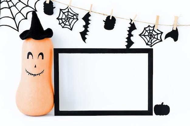Fundo de halloween com abóbora laranja de halloween e moldura preta