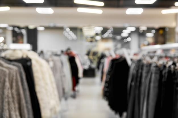 Fundo de imagem borrada com loja de roupas
